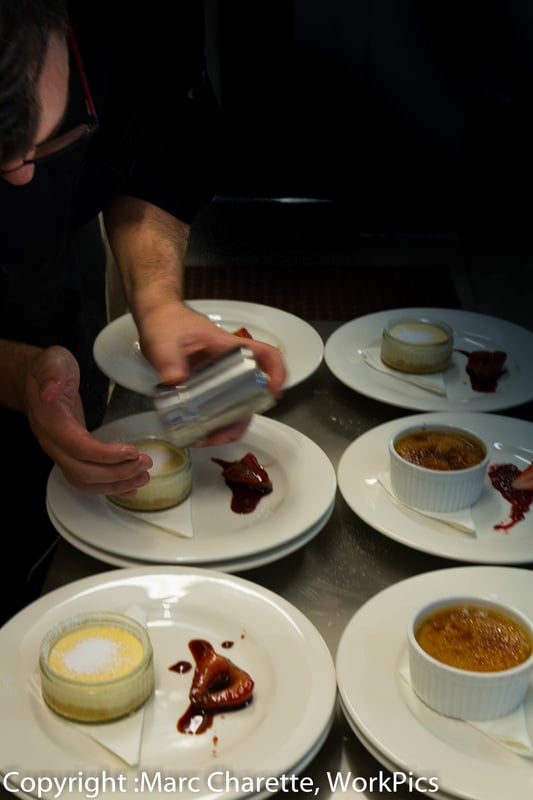 Commercial photography for restaurant of desserts being prepared in kitchen