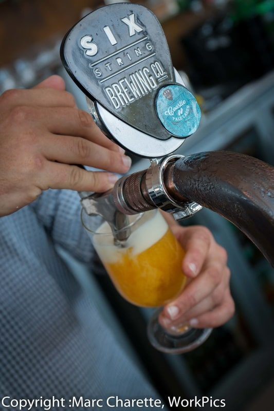 Commercial photography of Six String Brewing Co beer on tap at restaurant