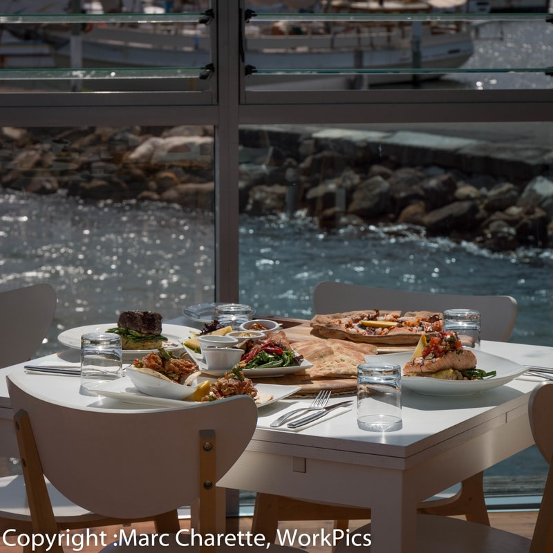 Commercial photography of meals served at table of waterfront restaurant